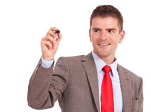 Business man writing with marker Royalty Free Stock Photos