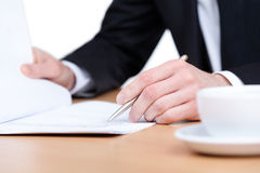 Business man writing in the notebook Stock Photo
