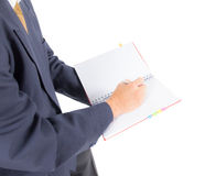 Business man writing on notebook Stock Photography