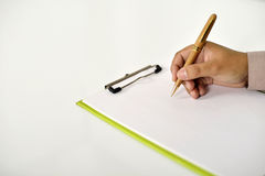 Business Man Writing On Clipboard Stock Photography