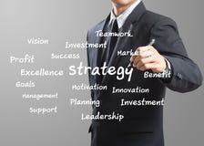 Business man writing Strategy Stock Photo