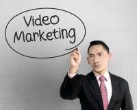Business man writing video marketing Stock Image