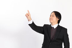 Business man writing whatever you want with him finger. Overwhite background stock image