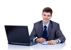 Business man writting at desk Stock Photography