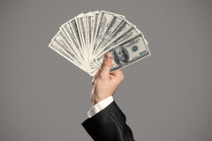 Business Man's Hand To Holding Money. Royalty Free Stock Image