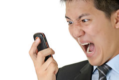 Business man yell to phone stock photography