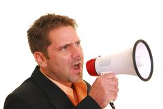 Business man yelling into a megaphone. Isolated against white Stock Photos