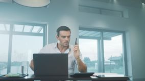 Business man yelling on mobile in luxury house. Angry man screaming on phone. stock footage