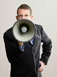 Business man yells into megaphone Royalty Free Stock Images