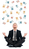 Business man in yoga position with bank note Royalty Free Stock Images
