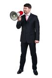 Business man. Young man shouting into a megaphone over a white background Royalty Free Stock Photo