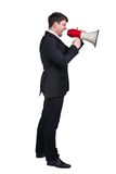 Business man. Young man shouting into a megaphone over a white background Stock Images
