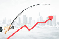Business management concept. Upward chart arrow suspended on fishing rod. City background. Business management concept. 3D Rendering Stock Images