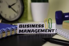 Business Management on the paper isolated on it desk. Business and inspiration concept stock photo