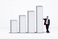 Business manager and bar chart on white Royalty Free Stock Photos