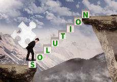 Business manager bring puzzle solution on mountain. Top royalty free stock photography