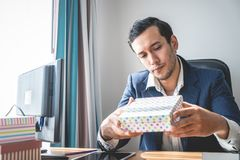 Business manager is checking the present product packaging stock photography
