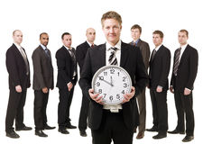 Business Manager with a clock. In front of his team Stock Image