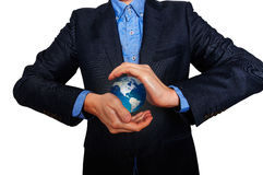 Business manager holding an Earth globe. Business man in suit Royalty Free Stock Images