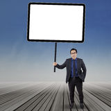 Business manager holding empty board Stock Photography