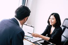 Business manager inviting new worker to sign contract. Business manager inviting new worker to sign work contract Stock Image