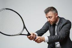Business Manager koncentrujący na grą obrazy stock