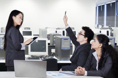 Business manager in meeting room with partners. Young businesswoman lead a business meeting in the office room with two partners Royalty Free Stock Photo