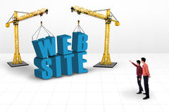 Business manager pointing website development. Business manager is pointing at website building and yellow cranes on white background Stock Images