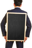 Business Manager przewożenia pusty blackboard Obraz Stock