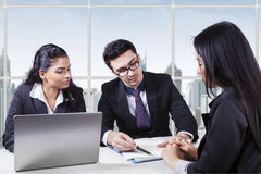 Business manager showing a document Stock Photo