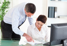 Business manager showing something on a document Stock Photography