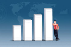 Business manager standing next to bar chart Stock Photography