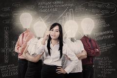 Business manager and team with light bulb heads Royalty Free Stock Image