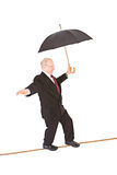 Business: Manager Walking Tightrope with Umbrella Stock Photography