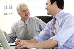 Business managers smiling to each other stock image