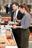 Business managers take croissants and jam at the Stock Images