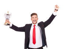 Business mancheering with cup Royalty Free Stock Photo