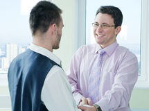 Business mans have a lucky meet with colleague Stock Photo