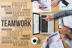 Business and marketing concepts. Business team hands at work with financial reports and a laptop, marketing and strategy concepts on the left, top view Stock Photo