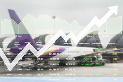 Business marketing data with arrow up show profit and success in. Travel business investment on index and graph of stock market data background Royalty Free Stock Images