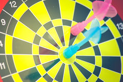 Business Marketing and Strategy Concept : Close up blue dart hit target on dart board in vintage filter effect. & x28;Soft Focus& x29 Royalty Free Stock Image