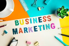 Business marketing word on desk office background with supplies. Colorful of business working table.marketing concepts Royalty Free Stock Photo