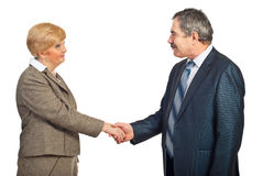 Business mature people acquaintance. Mature business woman and man making acquaintance and shaking hands isolated on white background stock photography