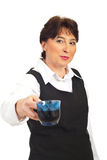Business mature woman offering coffee Royalty Free Stock Photo