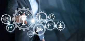 Business mechanism concept. Businessman touching trophy winner s. Uccessful and business processes workflows in gears icons on virtual screen Stock Photo
