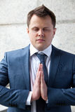 Business meditation. Successful businessman meditates with eyes closed Stock Photo