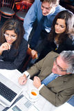 Business meeting. Group of business people looking at computer screen in a business meeting Royalty Free Stock Photos