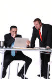 Business meeting. Two businessmen meeting together and reviewing work Royalty Free Stock Image
