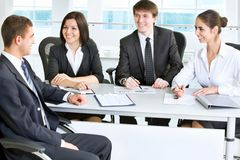 Business meeting. Young business people in a meeting at office Stock Image