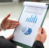 Business meeting. Stock market graphs monitoring. Accounting Stock Photos